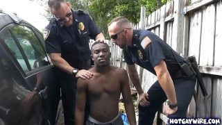 Two police officers take advantages of this black guy